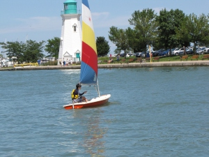 A young child sailing, shot at f 5.6, 1/1000 of a second, ISO 200