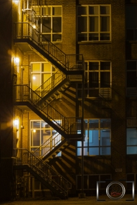 A Fire Escape at night, lit only from the left