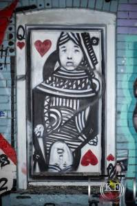 Graffiti of Queen of Hearts in a boarded up window